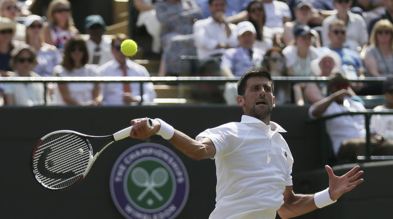 Serbia's Novak Djokovic plays against Czech Republic's Adam Pavlasek during their Men's Singles Match on day four at the Wimbledon Tennis Championships in London Thursday, July 6, 2017. (AP Photo/Tim Ireland)