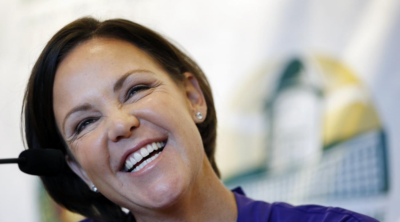 FILE - In this Saturday, July 12, 2014 file photo, Lindsay Davenport speaks with reporters during a news conference before being inducted into the Tennis Hall of Fame in Newport, R.I.. Three-time major champion and former No. 1 Lindsay Davenport of the U.