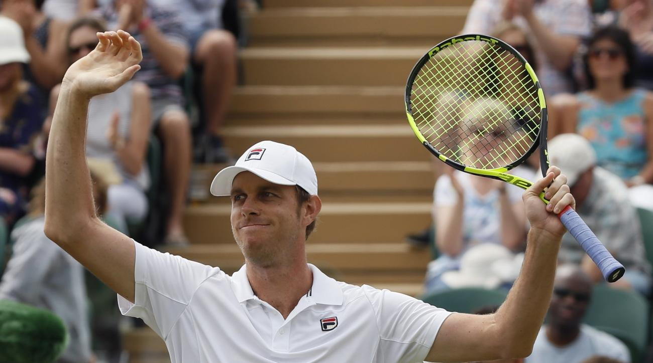 Sam Querrey of the United States celebrates after beating JoWilfried Tsonga of France in the Men's Singles Match on day six at the Wimbledon Tennis Championships in London Saturday, July 8, 2017. (AP Photo/Kirsty Wigglesworth)