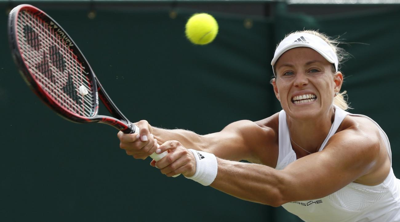 Germany's Angelique Kerber returns to Shelby Rogers of the United States during their Women's Singles Match on day six at the Wimbledon Tennis Championships in London Saturday, July 8, 2017. (AP Photo/Kirsty Wigglesworth)