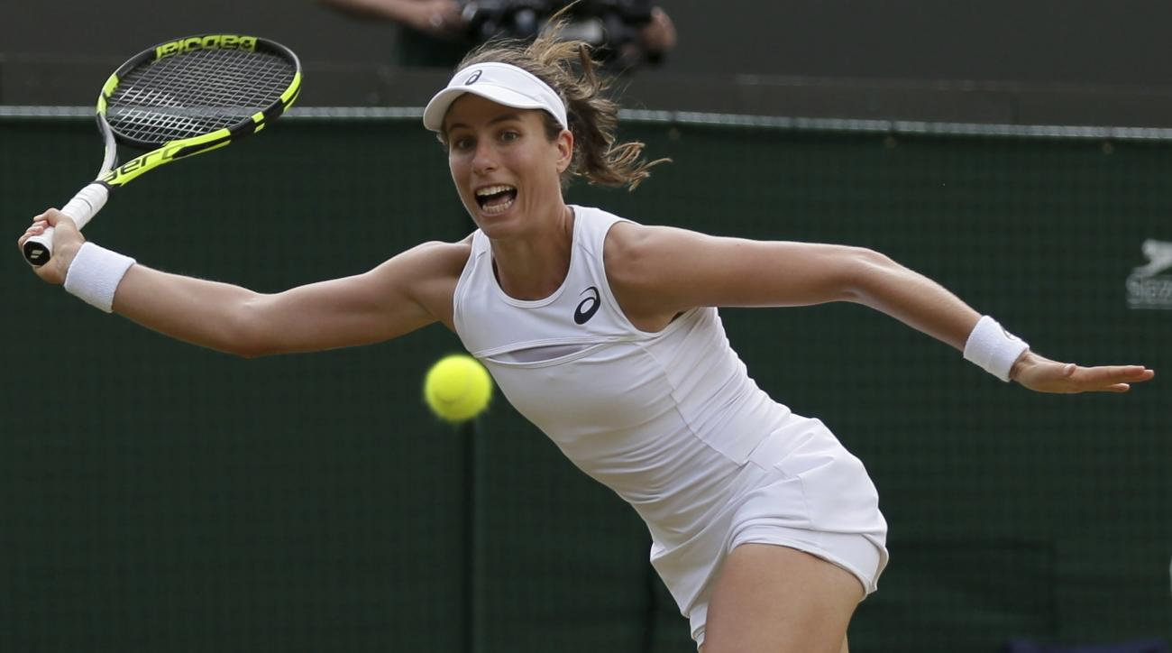Britain's Johanna Konta returns to Caroline Garcia of France during their Women's Singles Match on day seven at the Wimbledon Tennis Championships in London Monday, July 10, 2017. (AP Photo/Tim Ireland)