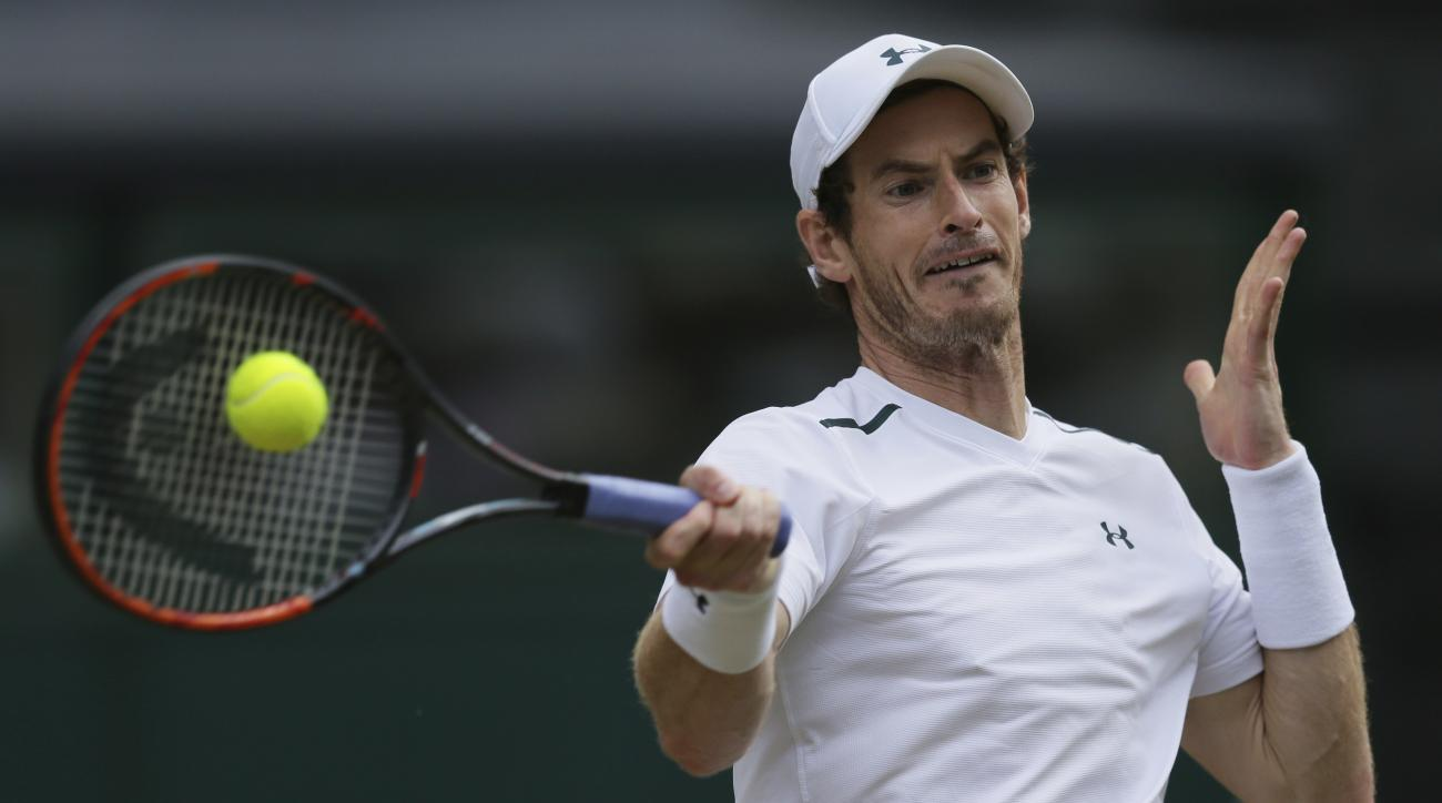 Britain's Andy Murray returns to Sam Querrey of the United States during their Men's Singles Quarterfinal Match on day nine at the Wimbledon Tennis Championships in London Wednesday, July 12, 2017. (AP Photo/Tim Ireland)