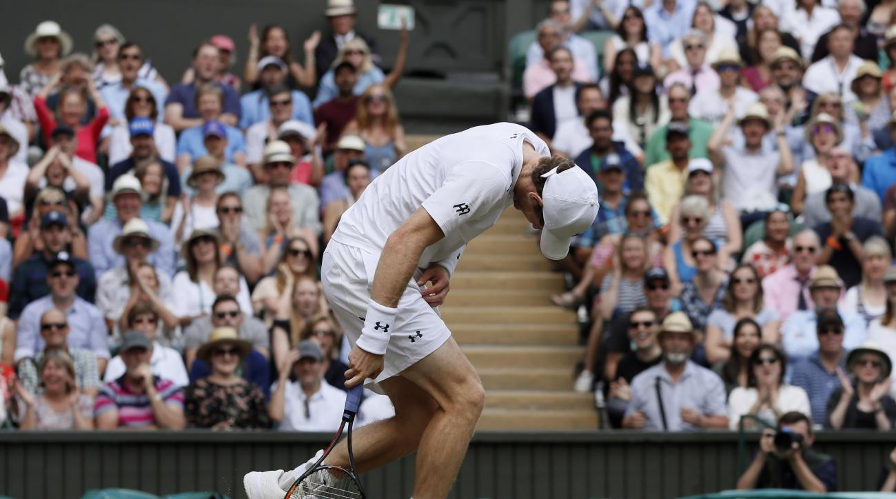 Britain's Andy Murray reacts as he loses a point to Sam Querrey of the United States during their Men's Singles Quarterfinal Match on day nine at the Wimbledon Tennis Championships in London Wednesday, July 12, 2017. (AP Photo/Kirsty Wigglesworth)