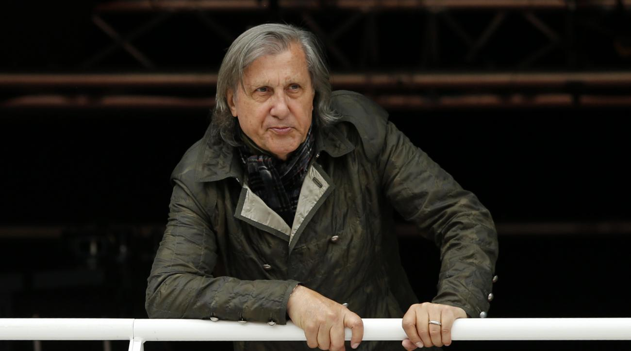 FILE - In this Monday, May 23, 2016 file picture, former Romanian tennis ace Ilie Nastase watches a match of the French Open tennis tournament at the Roland Garros stadium, in Paris, France. Suspended by the International Tennis Federation for his foul-mo