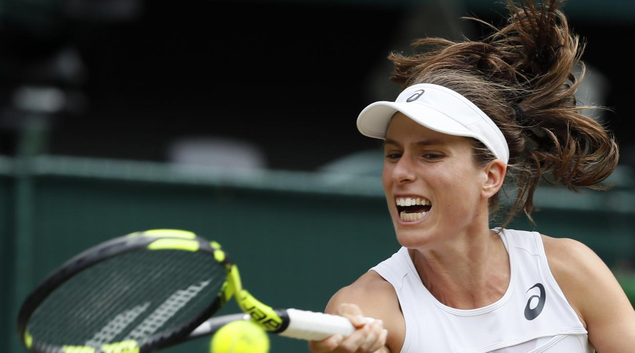 Britain's Johanna Konta returns to Venus Williams of the United States during their Women's Singles semifinal match on day nine at the Wimbledon Tennis Championships in London Thursday, July 13, 2017. (AP Photo/Kirsty Wigglesworth)