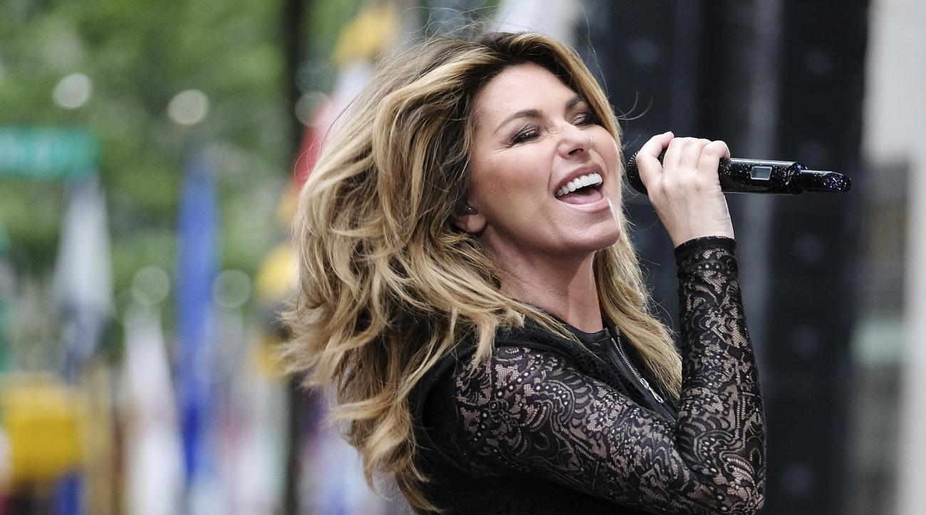 FILE - In this June 16, 2017, file photo, Shania Twain performs at Rockefeller Plaza in New York. Shania Twain will headline the opening-night ceremony at the U.S. Open. She will perform Aug. 28 at the Billie Jean King National Tennis Center. (Photo by Ch
