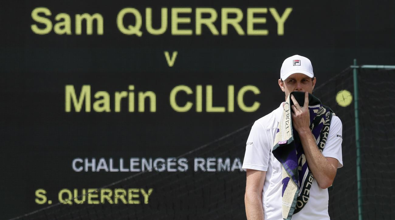 Sam Querrey of the United States waits for play to resume after a member of the crowd was taken ill as he plays against Croatia's Marin Cilic during their Men's Singles semifinal match on day eleven at the Wimbledon Tennis Championships in London, Friday,