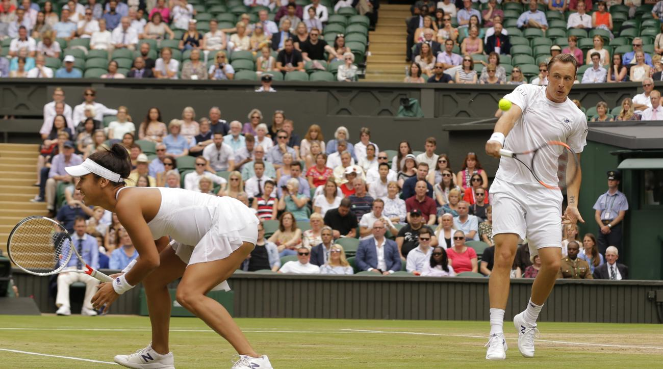 Finland's Henri Kontinen and Britain's Heather Watson return to Britain's Jamie Murray and Switzerland's Martina Hingis during the Mixed Doubles final match on day thirteen at the Wimbledon Tennis Championships in London Sunday, July 16, 2017. (AP Photo/A