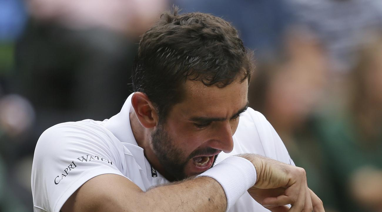 Croatia's Marin Cilic reacts as he plays Switzerland's Roger Federer in the Men's Singles final match on day thirteen at the Wimbledon Tennis Championships in London Sunday, July 16, 2017. (AP Photo/Tim Ireland)