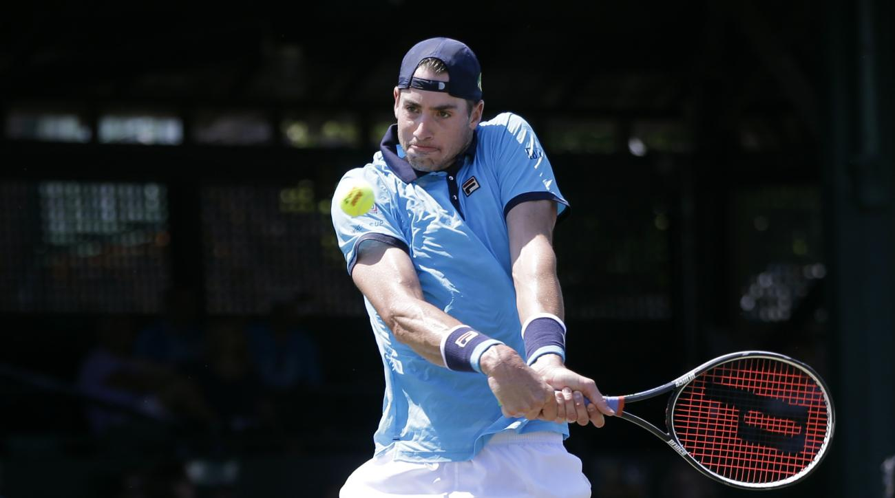 Top seed John Isner returns the ball to Dennis Novikov in their quarterfinal match at the Hall of Fame Tennis Championships, Friday, July 21, 2017, in Newport, R.I. Isner won 6-4, 6-4. (AP Photo/Elise Amendola)