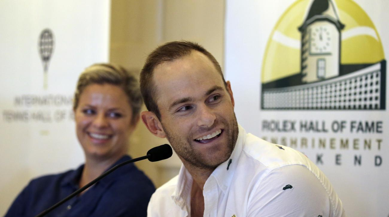 Tennis Hall of Fame inductees Kim Clijsters of Belgium and Andy Roddick of the United States laugh during a news conference before enshrinement ceremonies at the International Tennis Hall of Fame, Saturday, July 22, 2017, in Newport, R.I. (AP Photo/Elise