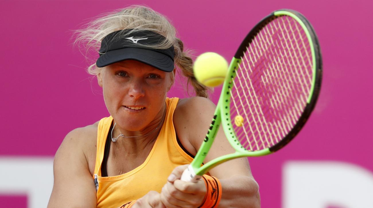 Kiki Bertens of the Netherlands  returns a shot during the final match against Anett Kontaveit of Estonia, at the WTA Ladies Championship tennis tournament in Gstaad, Switzerland, sunday, July 23, 2017. (Peter Klaunzer/Keystone via AP)