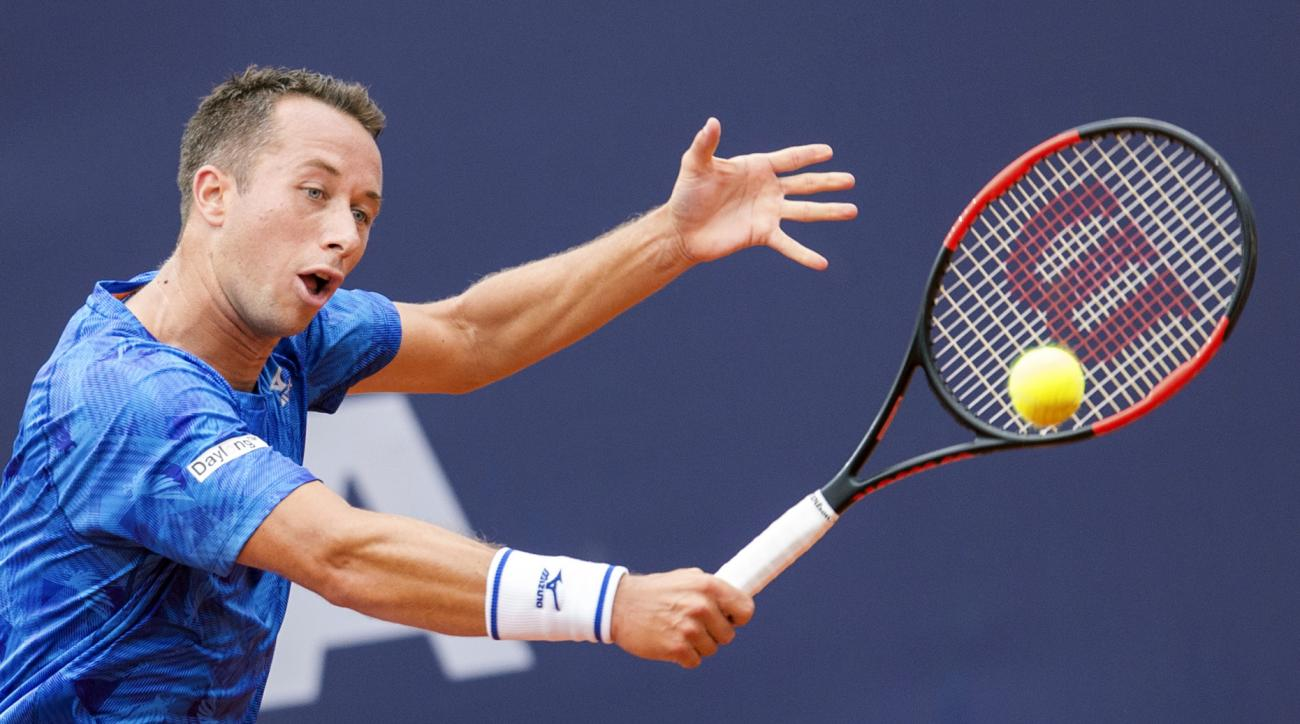 Germany's Philipp Kohlschreiber returns to France's G. Simon, during their men's singles match at the German Open tennis tournament in Hamburg, Germany, Thursday, July 27, 2017. (Daniel Bockwoldt/dpa via AP)