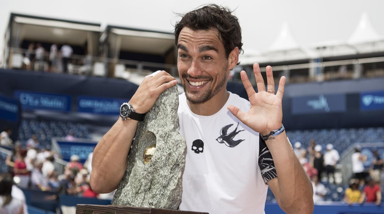 Fabio Fognini of Italy celebrates with the tophy after winning the final match against Yannick Hanfmann of Germany during the final game at the Swiss Open tennis tournament in Gstaad, Switzerland, Sunday, July 30, 2017. (Peter Schneider/Keystone via AP)