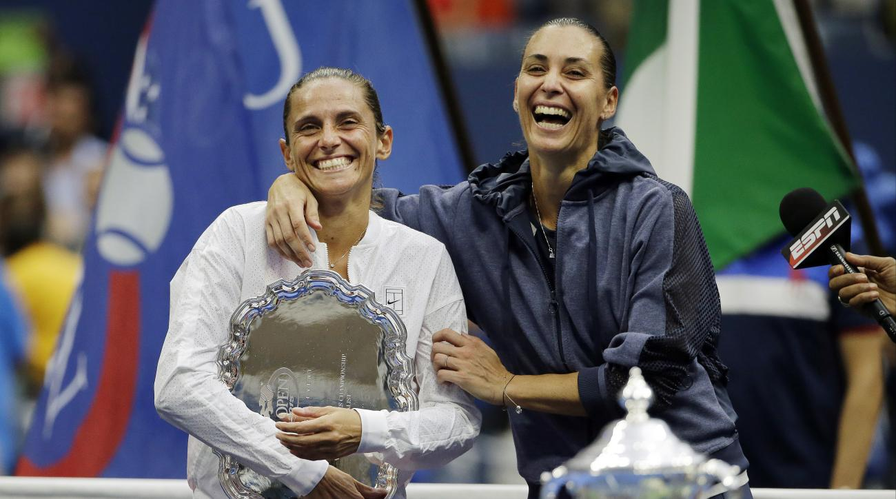 FILE  - In this Saturday, Sept. 12, 2015 file photo Roberta Vinci, of Italy, left, and Flavia Pennetta, of Italy, react during the trophy ceremony for the women's championship match of the U.S. Open tennis tournament, in New York.  Former U.S. Open runner