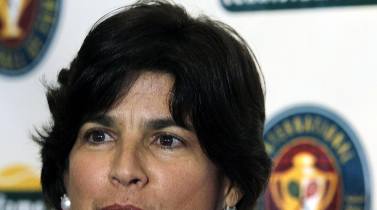 FILE - In this July 10, 2010, file photo, tennis player Gigi Fernandez, of Puerto Rico, speaks during a news conference prior to being inducted with doubles partner Natasha Zvereva into the International Tennis Hall of Fame in Newport, R.I. Fernandez's pr