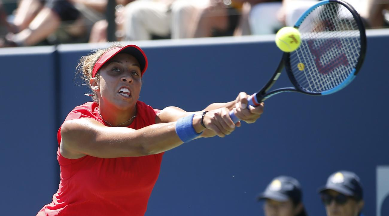 Madison Keys, of the United States, returns to Coco Vandeweghe, of the United States, during the finals of the Bank of the West Classic tennis tournament in Stanford, Calif., Sunday, Aug. 6, 2017. (AP Photo/Tony Avelar)