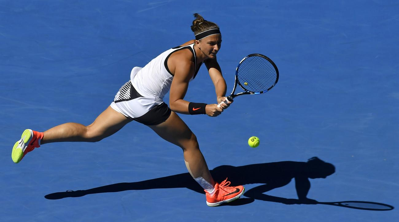 FILE - In this file photo dated Thursday, Jan. 19, 2017, Italy's Sara Errani makes a return to Russia's Ekaterina Makarova during their second round match at the Australian Open tennis championships in Melbourne, Australia. International Tennis Federation
