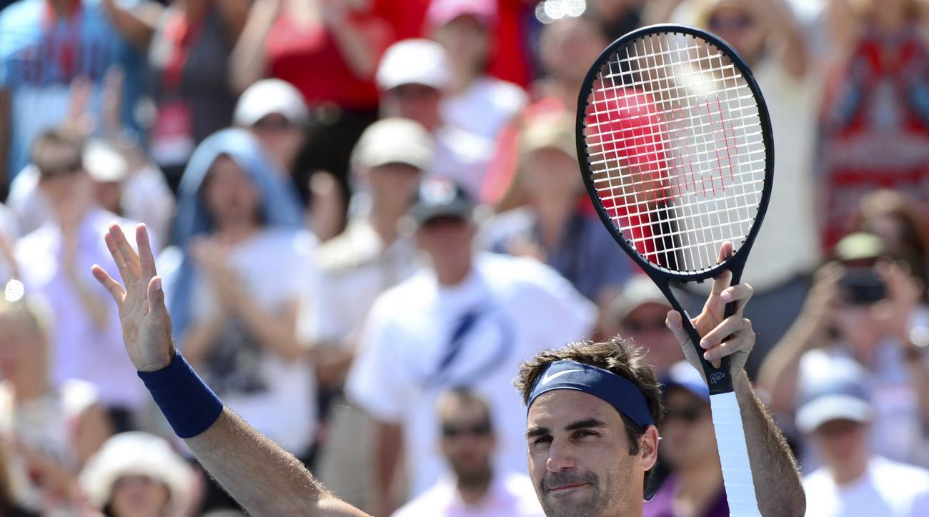 Switzerland's Roger Federer celebrates his win over Canada's Peter Polansky at the Rogers Cup tennis tournament, Wednesday, Aug. 9, 2017 in Montreal. (Paul Chiasson/The Canadian Press via AP)