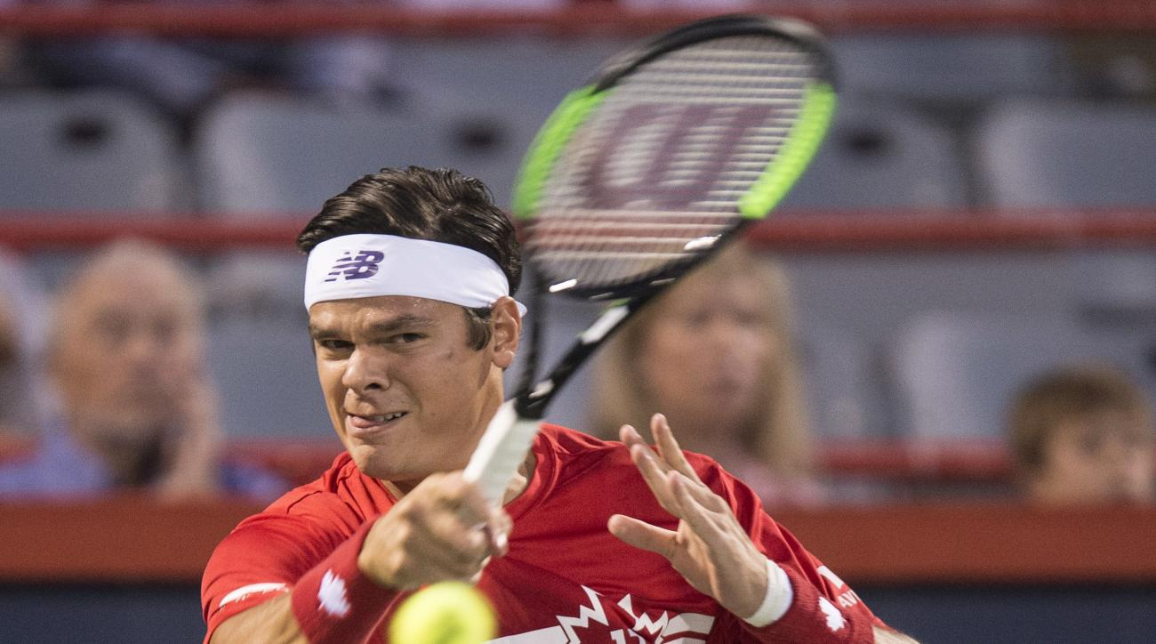Milos Raonic of Canada returns to Adrian Mannarino of France during the Rogers Cup mens tennis tournament, Wednesday, Aug. 9, 2017 in Montreal. (Paul Chiasson/The Canadian Press via AP)