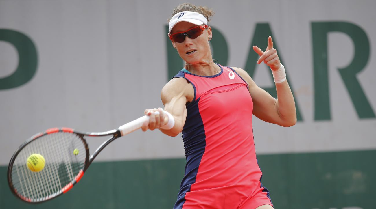 Australia's Samantha Stosur plays a shot against Latvia's Jelena Ostapenko during their fourth round match of the French Open tennis tournament at the Roland Garros stadium, in Paris, France. Sunday, June 4, 2017. (AP Photo/Michel Euler)