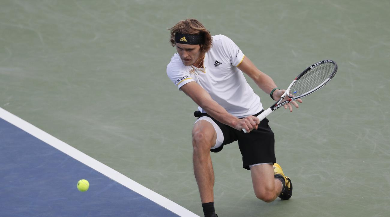 File-This Aug. 16, 2017, file photo shows Alexander Zverev, of Germany, returning to Frances Tiafoe during the middle rounds at the Western & Southern Open tennis tournament, in Mason, Ohio. (AP Photo/John Minchillo, File)