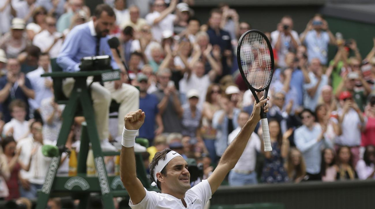 File-This Julyb16, 2017, file photo shows Switzerland's Roger Federer celebrating after defeating Croatia's Marin Cilic to win the Men's Singles final match at the Wimbledon Tennis Championships in London. Federer is back. All the way back. He's back at t