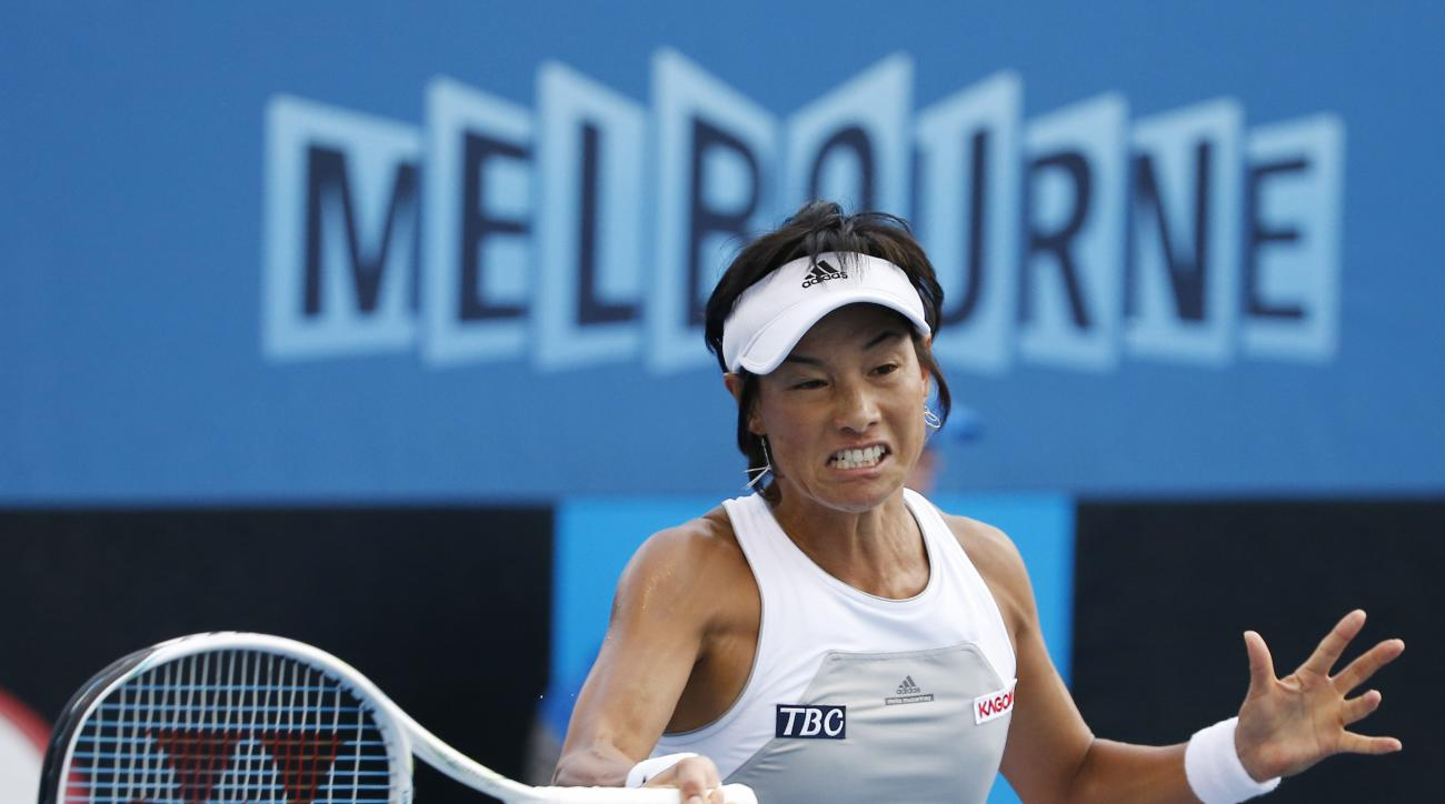 Kimiko Date-Krumm of Japan makes a forehand return to Anna Tatishvili of the U.S. during their first round match at the Australian Open tennis championship in Melbourne, Australia, Tuesday, Jan. 20, 2015. (AP Photo/Vincent Thian)