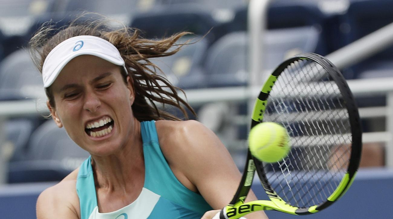 Johanna Konta, of Great Britain, returns a shot from Aleksandra Krunic, of Serbia, during the first round of the U.S. Open tennis tournament, Monday, Aug. 28, 2017, in New York. (AP Photo/Frank Franklin II)