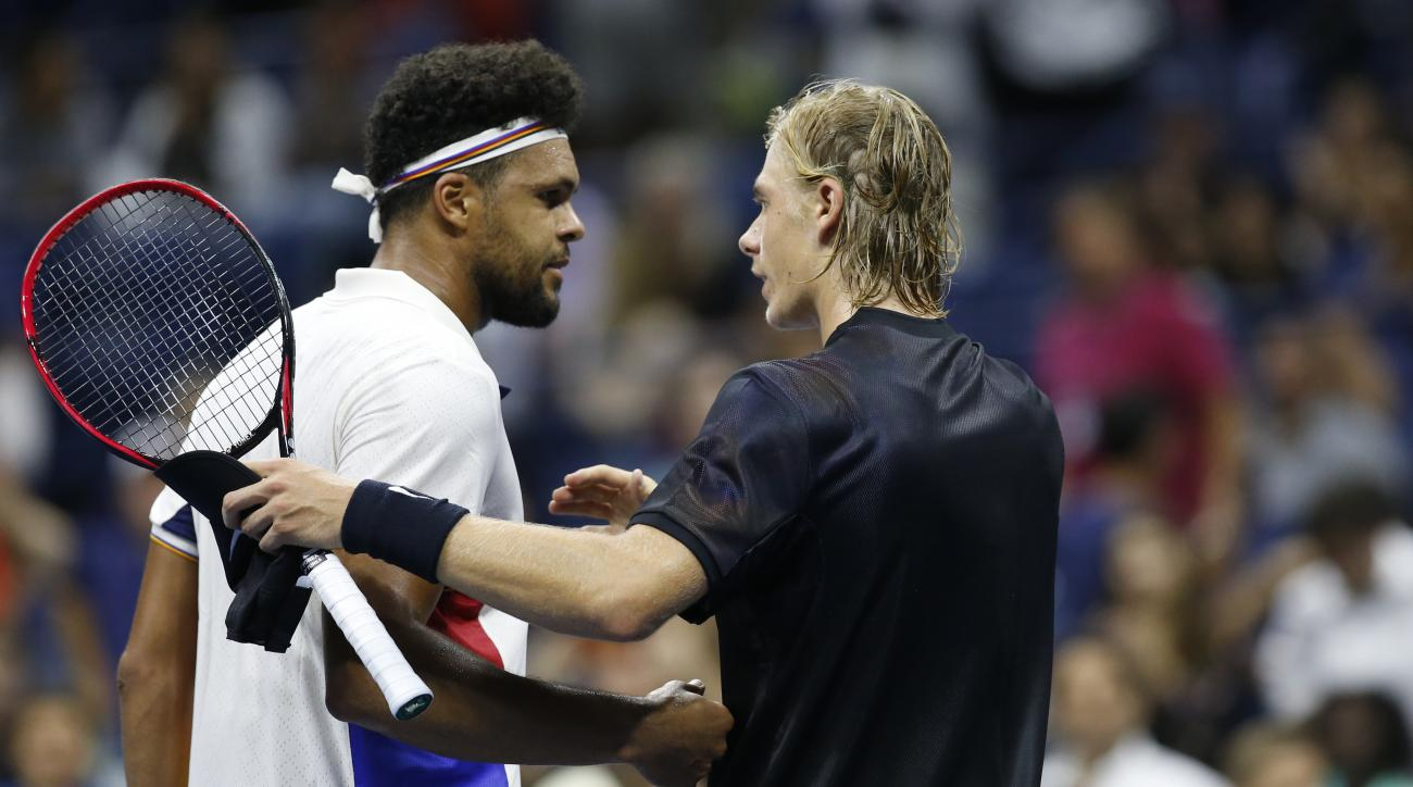 Denis Shapovalov, right, of Canada, greets Jo-Wilfried Tsonga, of France, after defeating No. 8 seed Tsonga 6-4, 6-4, 7-6 (3) at the U.S. Open tennis tournament in New York, Wednesday, Aug. 30, 2017. (AP Photo/Kathy Willens)