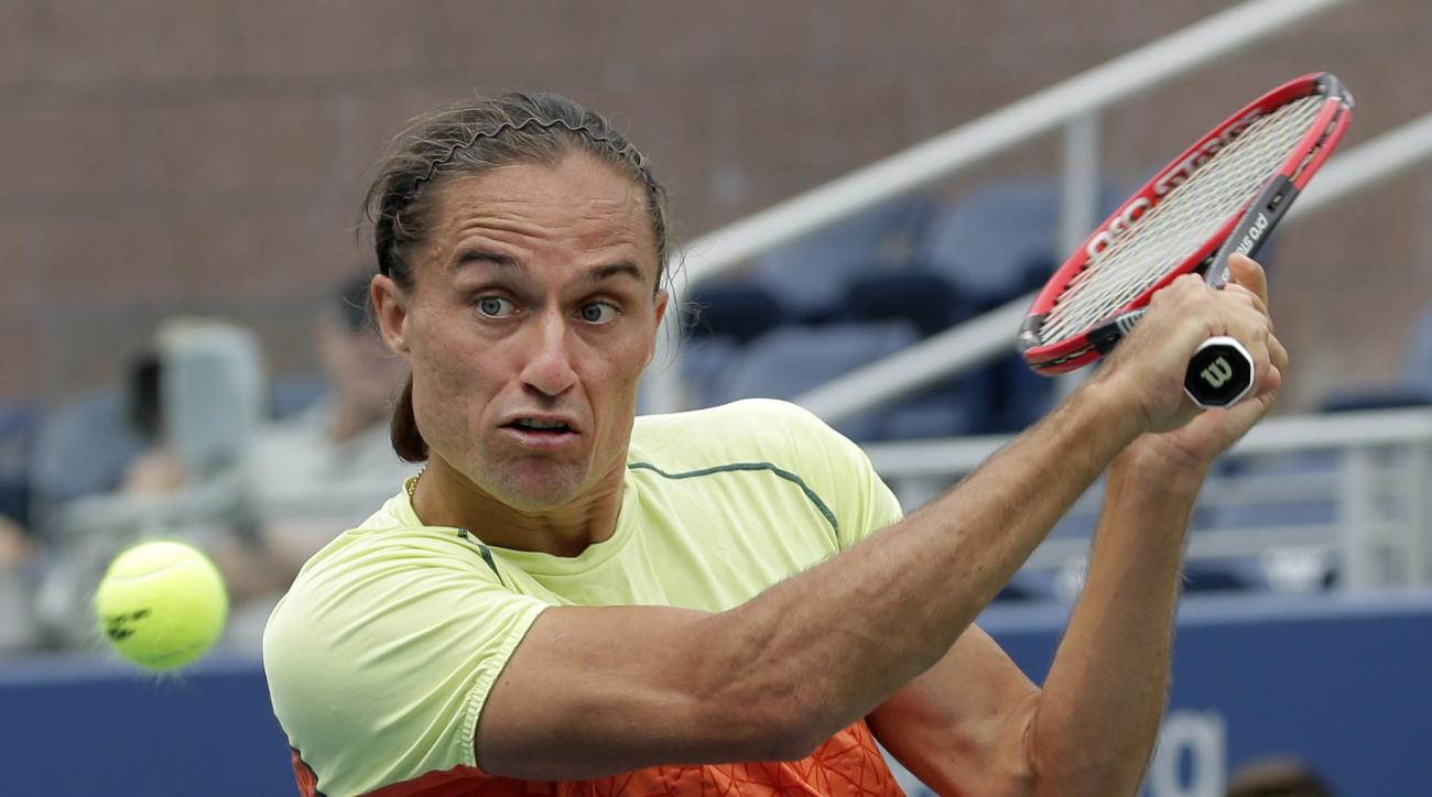 Alexandr Dolgopolov, of Ukraine, returns a shot from Viktor Troicki, of Serbia, during the third round of the U.S. Open tennis tournament, Saturday, Sept. 2, 2017, in New York. (AP Photo/Peter Morgan)