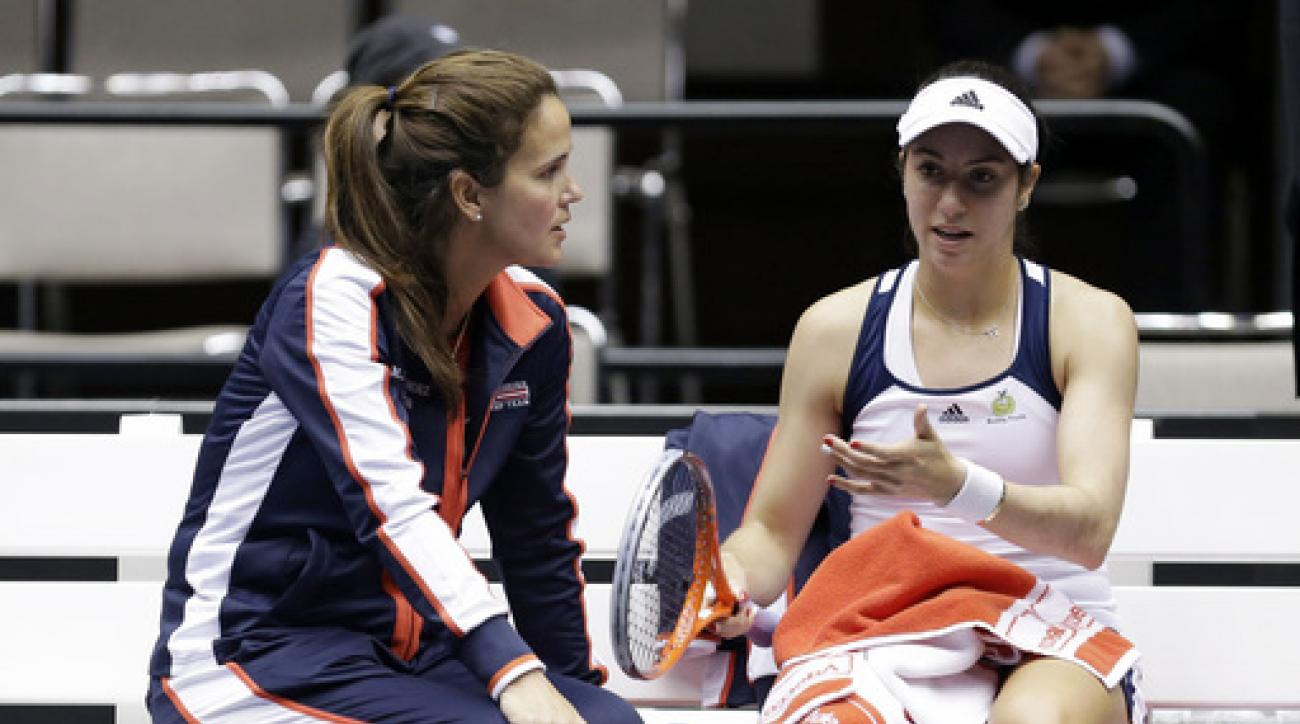 FILE - In this Feb. 8, 2014, file photo, United States' Christina McHale, right, talks with coach Mary Joe Fernandez during a break in a Fed Cup world group tennis match against Italy's Karin Knapp in Cleveland. Knapp won the match. Fernandez says whether