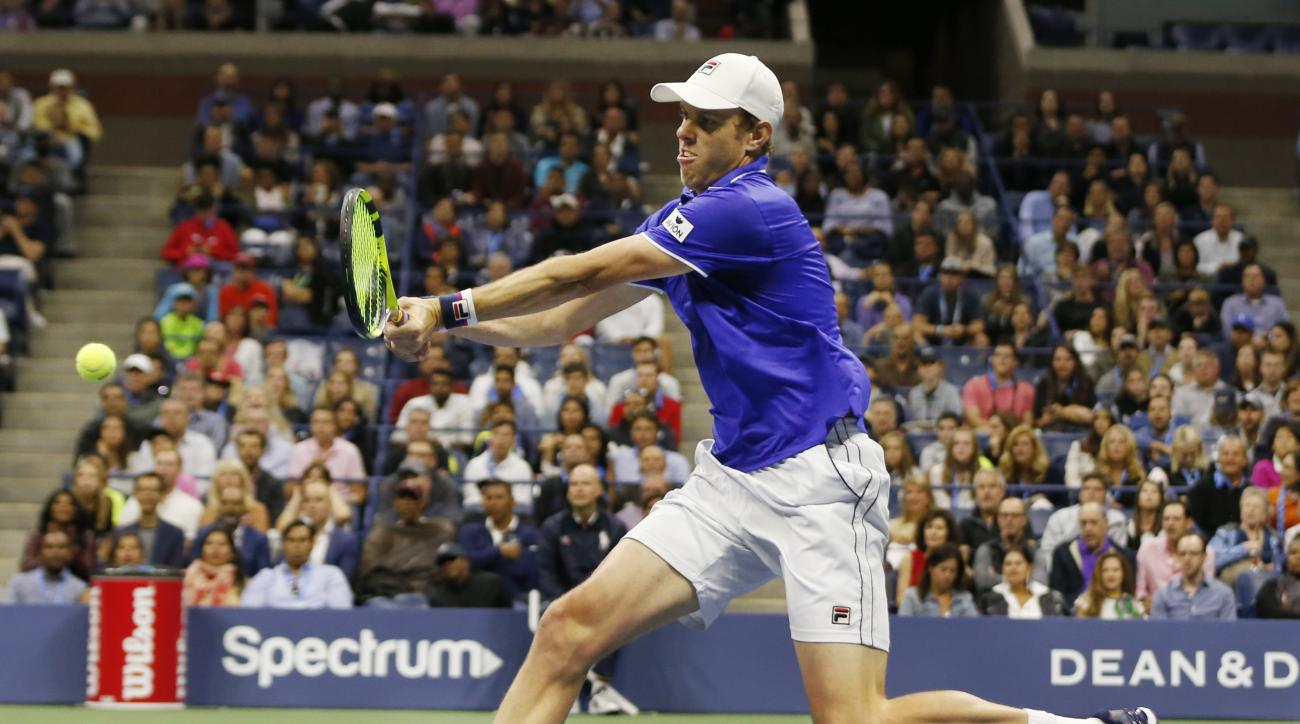 Sam Querrey, of the United States, goes for a shot in the first set of his fourth round match against Mischa Zverev, of Germany, at the U.S. Open tennis tournament in New York, Sunday, Sept. 3, 2017. (AP Photo/Kathy Willens)