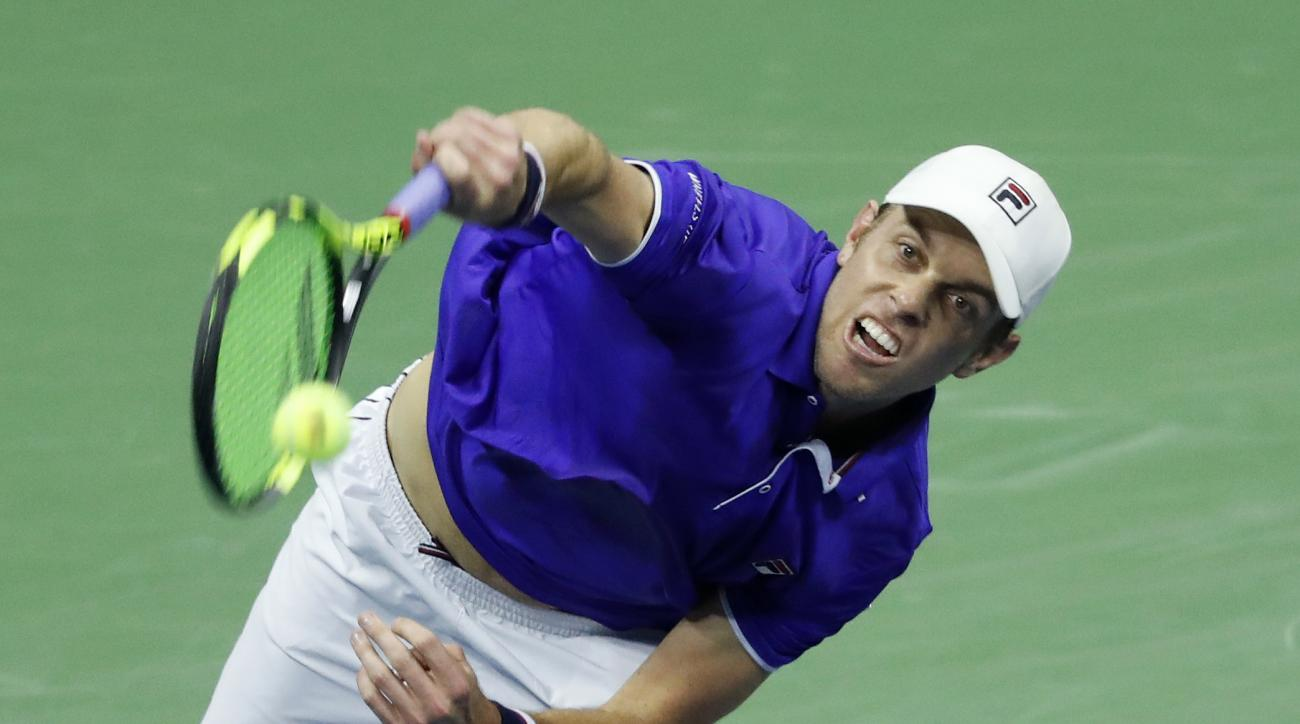 Sam Querrey, of the United States, serves against Mischa Zverev, of Germany, during the fourth round of the U.S. Open tennis tournament, Sunday, Sept. 3, 2017. (AP Photo/Adam Hunger)