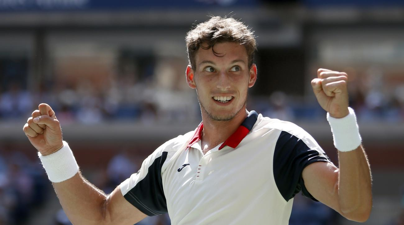 Pablo Carreno Busta, of Spain, reacts after beating Diego Schwartzman, of Argentina, during the quarterfinals of the U.S. Open tennis tournament, Tuesday, Sept. 5, 2017, in New York. (AP Photo/Jason Decrow)