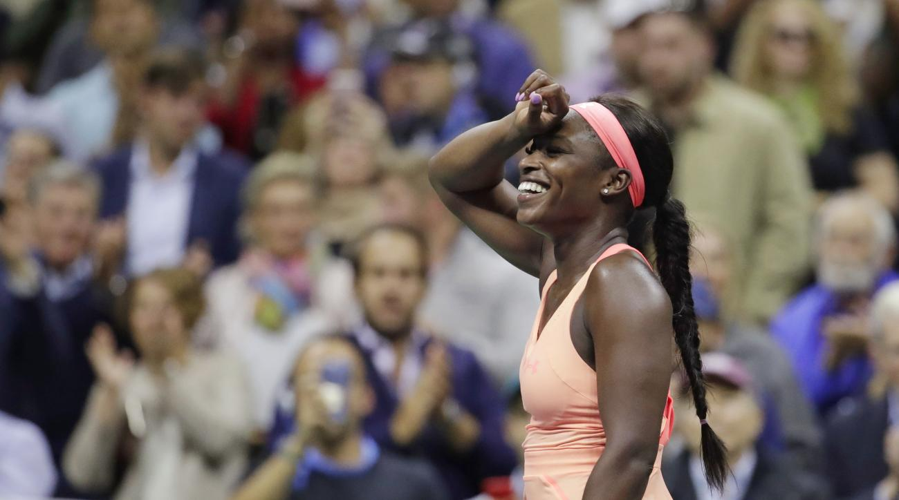 Sloane Stephens, of the United States, reacts after defeating Venus Williams, of the United States, during the semifinals of the U.S. Open tennis tournament, Thursday, Sept. 7, 2017, in New York. (AP Photo/Julio Cortez)