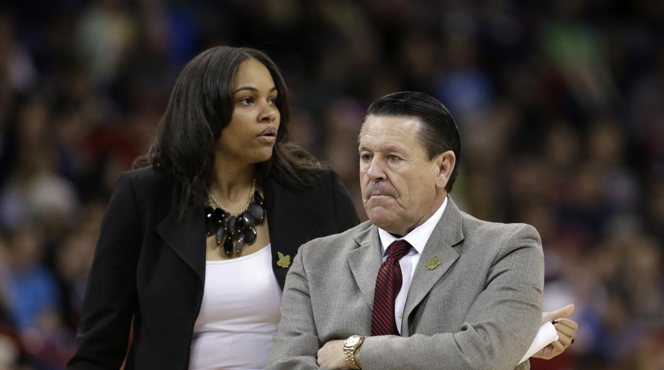 Georgia head coach Andy Landers, right, and  assistant coach Joni Crenshaw in action against Stanford in a regional semifinal in the NCAA women's college basketball tournament Saturday, March 30, 2013, in Spokane, Wash. (AP Photo/Elaine Thompson)