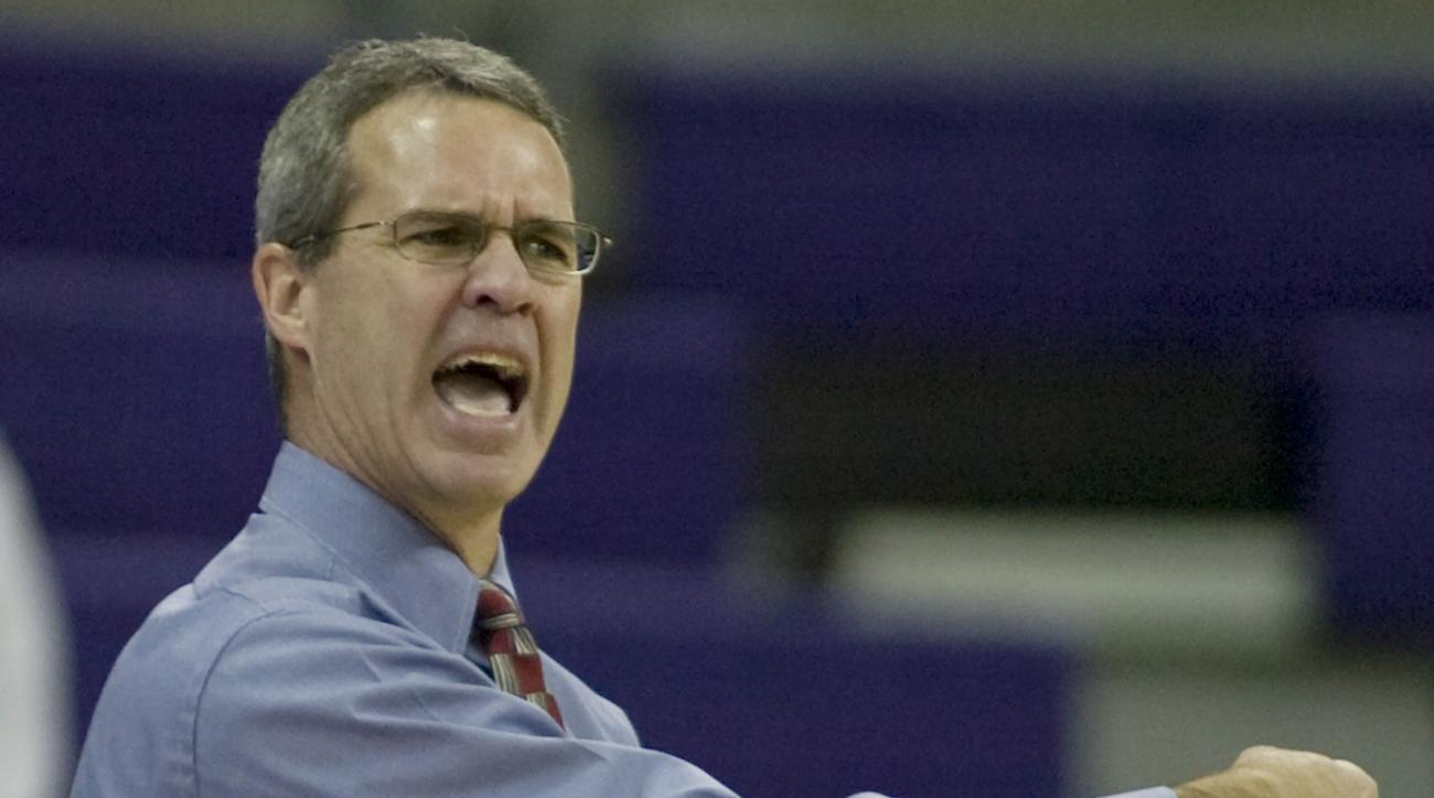 Idaho head coach Mike Divilbiss reacts during the second half of a college basketball game against Weber State in the Husky Classic Sunday, Nov. 25, 2007 in Seattle. Weber State beat Idaho 56-48. (AP Photo/Jim Bryant)