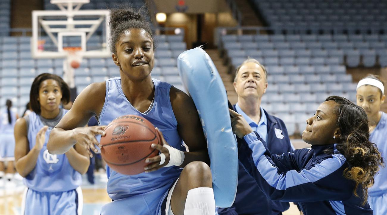 North Carolina's Diamond DeShields, left, practices rebounding under pressure from Assistant Coach Ivory Latta, right, during practice for the NCAA women's college basketball tournament in Chapel Hill, N.C., March 22, 2014. North Carolina plays UT-Martin