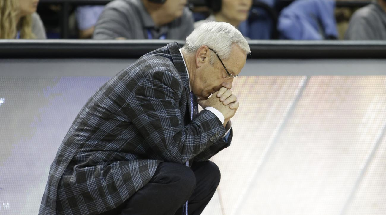 FILE - In this March, 2015 file photo, North Carolina head coach Roy Williams bows his head during the second half of an NCAA college basketball game against Virginia in the semifinals of the Atlantic Coast Conference tournament in Greensboro, N.C. The NC