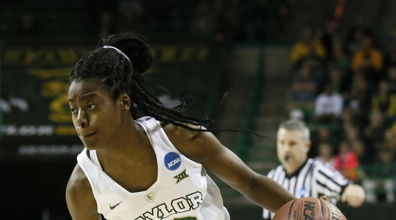 Baylor's Imani Wright (20) handles the ball during the first half of a women's college basketball game against Arkansas in the second round of the NCAA tournament Sunday, March 22, 2015, in Waco, Texas. (AP Photo/Tony Gutierrez)