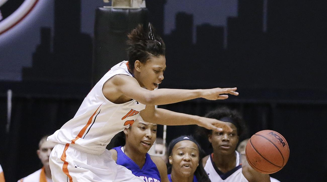 Tennessee Martin forward Ashia Jones, left, reaches for a rebound in the second half of an NCAA college basketball game against Tennessee State in the final round of the Ohio Valley Conference tournament Saturday, March 7, 2015, in Nashville, Tenn. Tennes