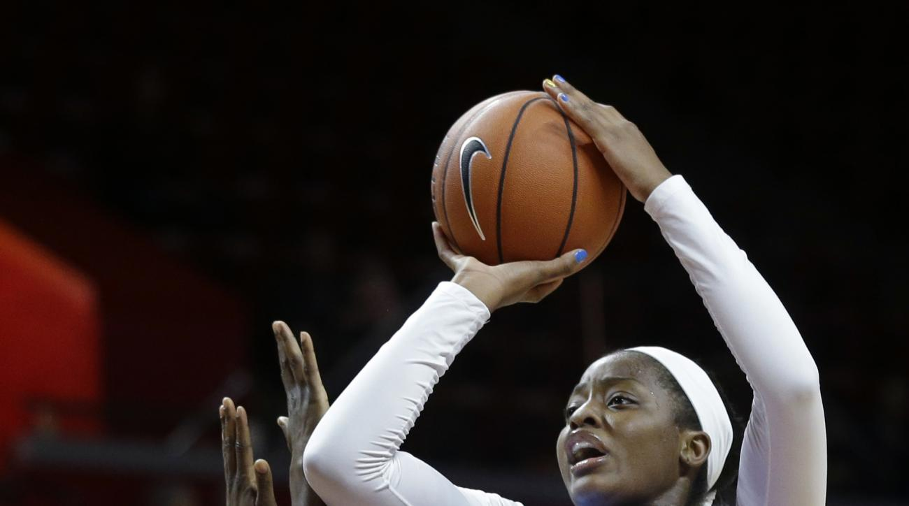 North Carolina's Stephanie Mavunga (1) takes a shot past Rutgers' Sye (15) during the first half of a women's NCAA college basketball game Thursday, Dec. 4, 2014, in Piscataway, N.J. (AP Photo/Mel Evans)