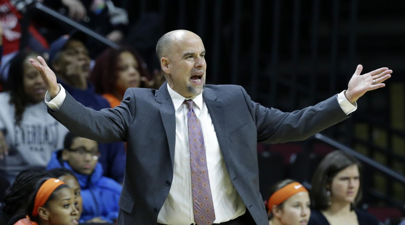 FILE - In this Feb. 17, 2015, file photo, Illinois head woman's basketball coach Matt Bollant reacts to a call during an NCAA college basketball game in Piscataway, N.J.  A Chicago law firm hired by the University of Illinois to investigate allegations of