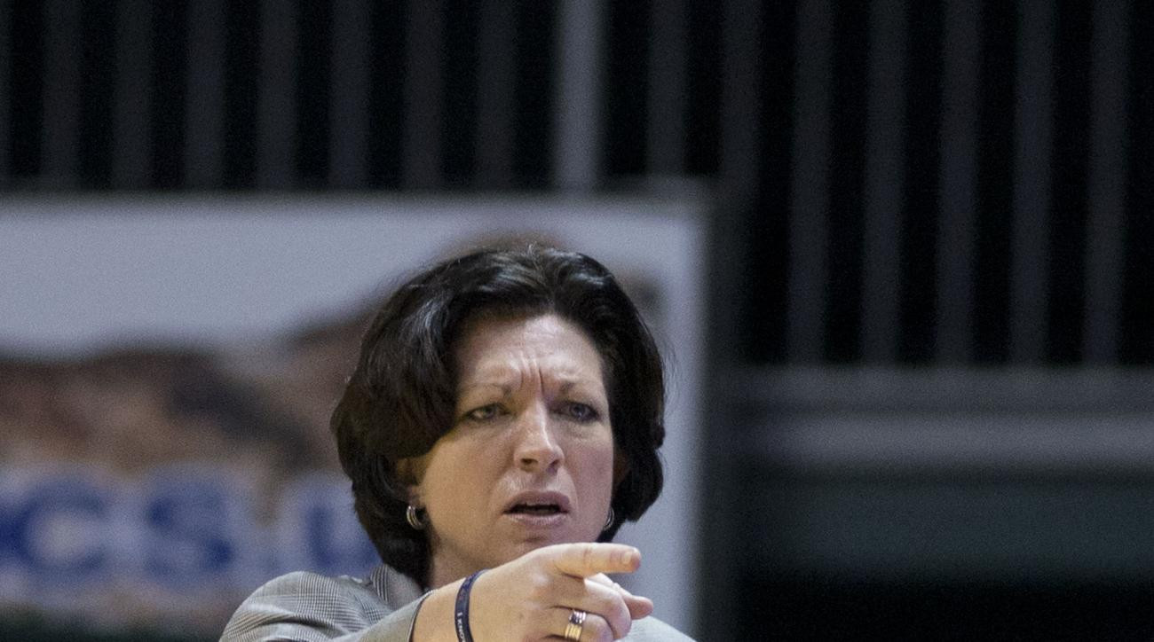 Miami coach Katie Meier yells instructions during the first half of an NCAA college basketball game against Florida State in Coral Gables, Fla., Sunday, March 1, 2015. (AP Photo/J Pat Carter)