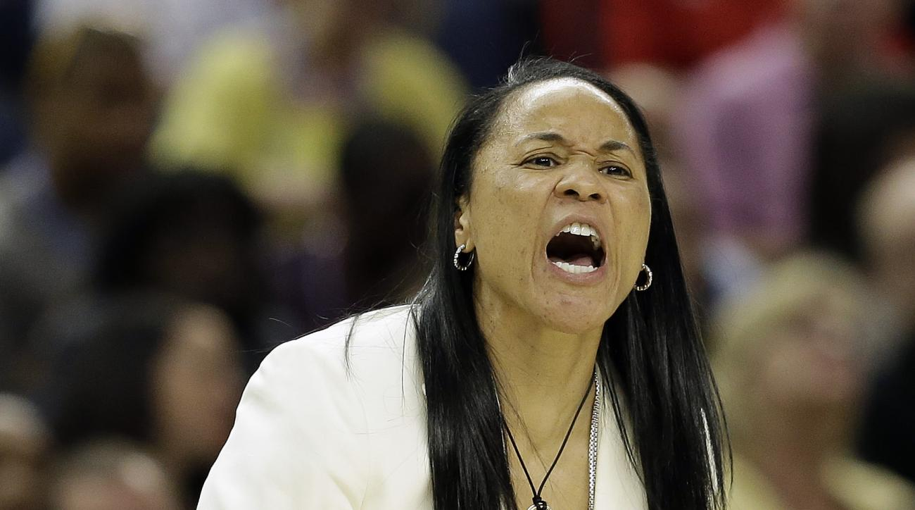 South Carolina head coach Dawn Staley speaks to players during the second half of the NCAA Women's Final Four tournament college basketball semifinal game against Notre Dame, Sunday, April 5, 2015, in Tampa, Fla. (AP Photo/John Raoux)