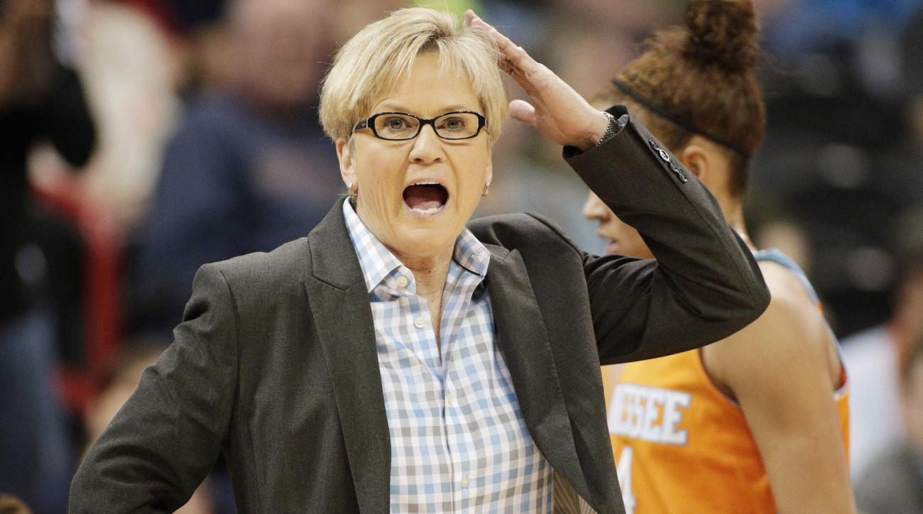 FILE - In this March 30, 2015, file photo, Tennessee head coach Holly Warlick instructs her team during a women's college basketball regional final game against Maryland in the NCAA tournament in Spokane, Wash. Warlick has received a one-year contract ext
