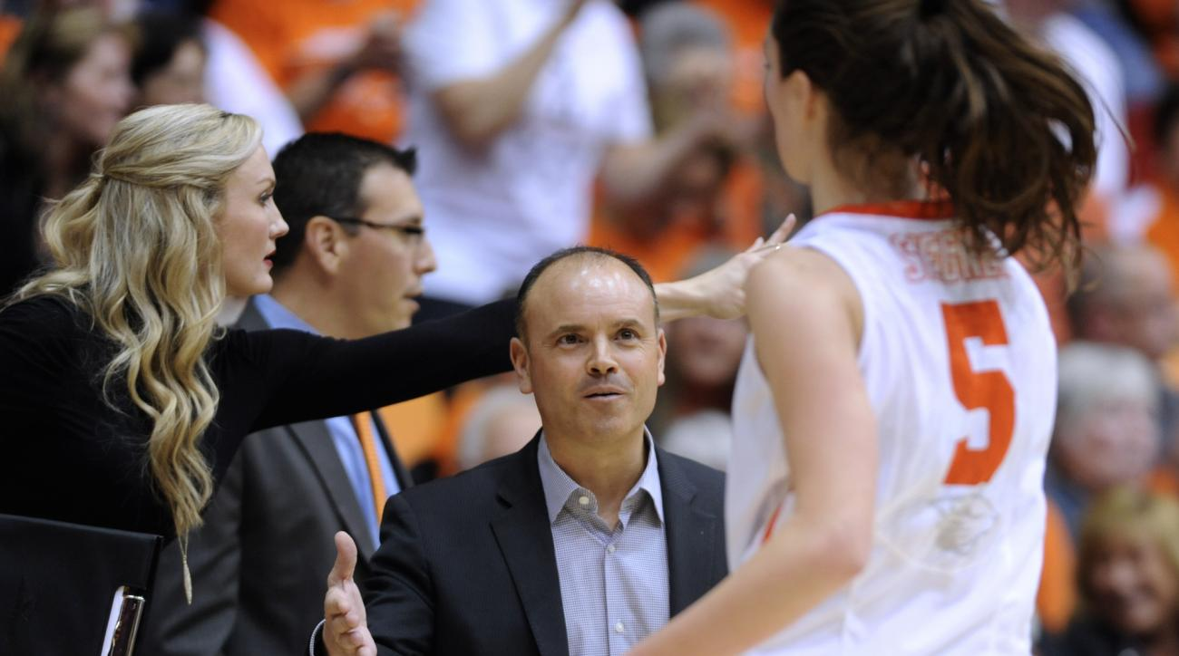 Oregon State coach Scott Rueck, center, greets Samantha Siegner (5) as she leaves the floor against Washington State during the second half of an NCAA college basketball game in Corvallis, Ore., Friday, Jan. 16, 2015. Oregon State won 73-70. (AP Photo/Gre
