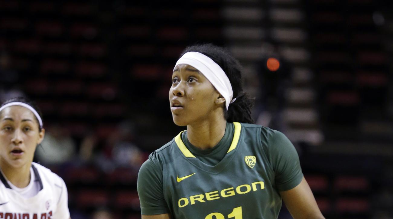 Oregon's Chrishae Rowe (21) moves in as Washington State's Lia Galdeira defends in the first half of an NCAA college basketball game in the Pac-12 women's tournament Thursday, March 6, 2014, in Seattle. (AP Photo/Elaine Thompson)