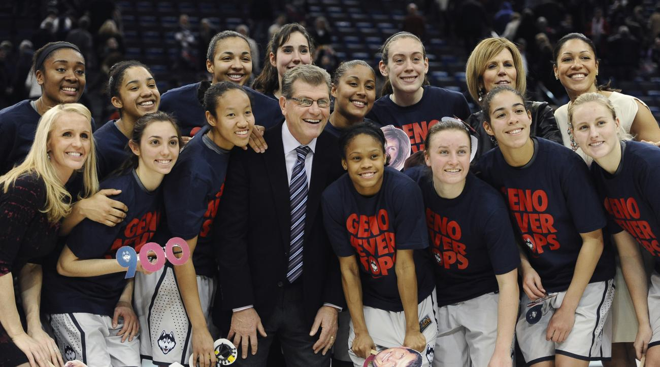 FILE - In this Feb. 3, 2015, file photo, Connecticut coach Geno Auriemma, center, poses with his team after his 900th career win, in an NCAA college basketball game against Cincinnati, in Hartford, Conn. Auriemma and the UConn Huskies are starting this se